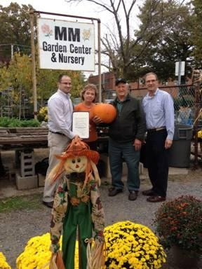 Assemblyman Ed Ra (left) and local officials congratulating MM Garden Center in Garden City South on their 45th anniversary.