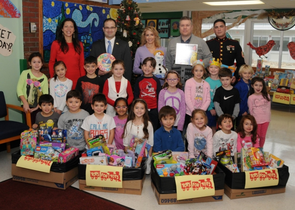 New York State Assemblyman Edward Ra and Nassau County Legislator Laura Schaefer are seen with Pastor John Gravagna of Connect Church of Bellmore, Sergeant Torres, and Principal Dr. Suzanne Viscovich of Homestead School in Garden City whose students collected toys for the Toys for Tots Program in conjunction with the United States Marine Corps.
