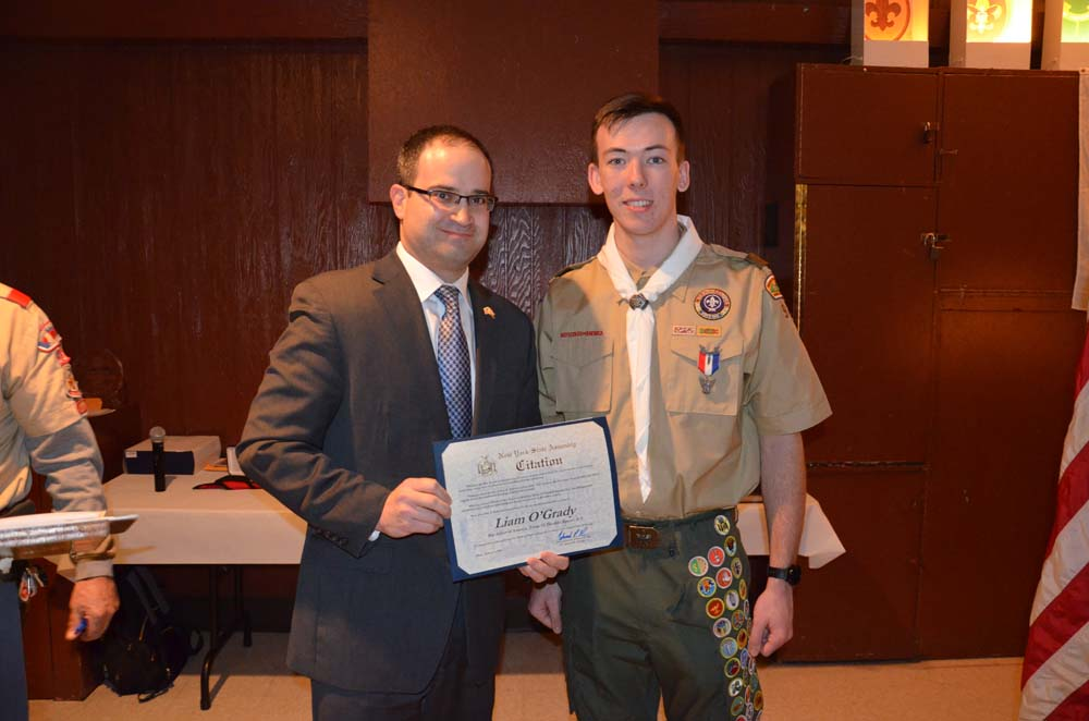 Assemblyman Ed Ra presents an Assembly Citation to Eagle Scout Liam O'Grady.