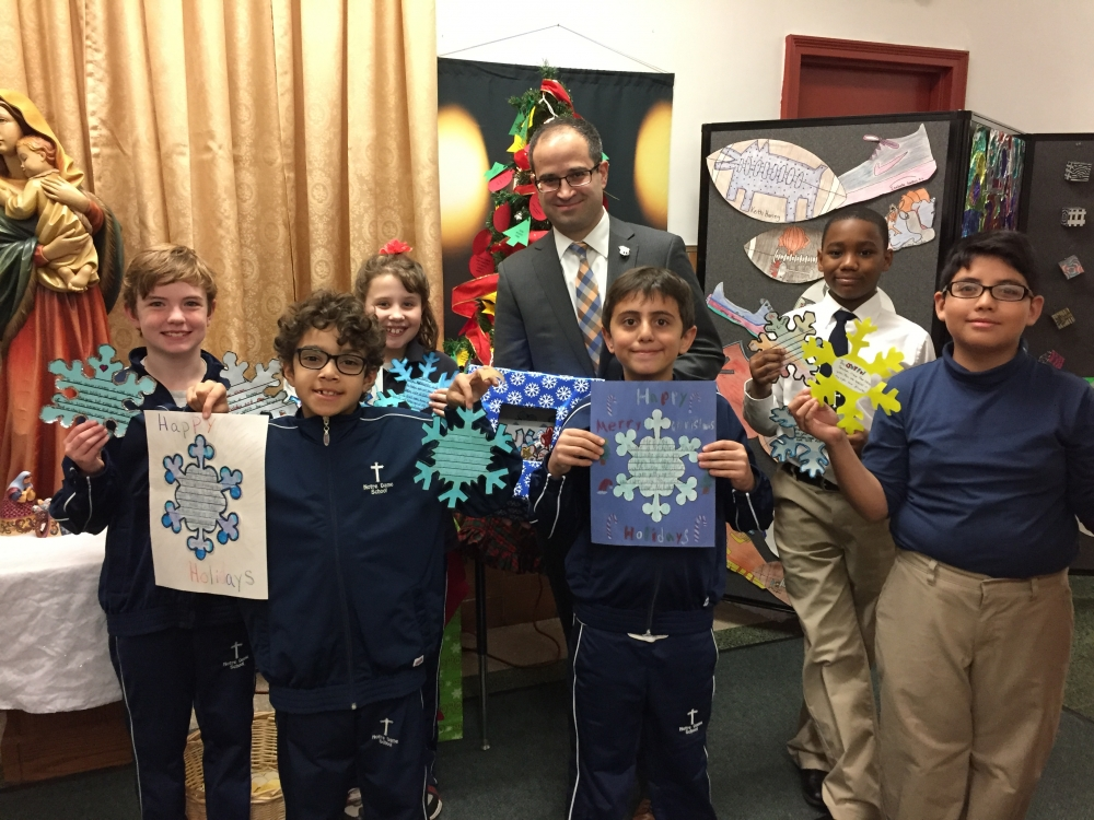 The attached photos depict Assemblyman Ed Ra (R-Franklin Square) with third, fourth and fifth graders of Notre Dame School in New Hyde Park and residents of The Plattduetsche Home Society in Franklin Square.<br />