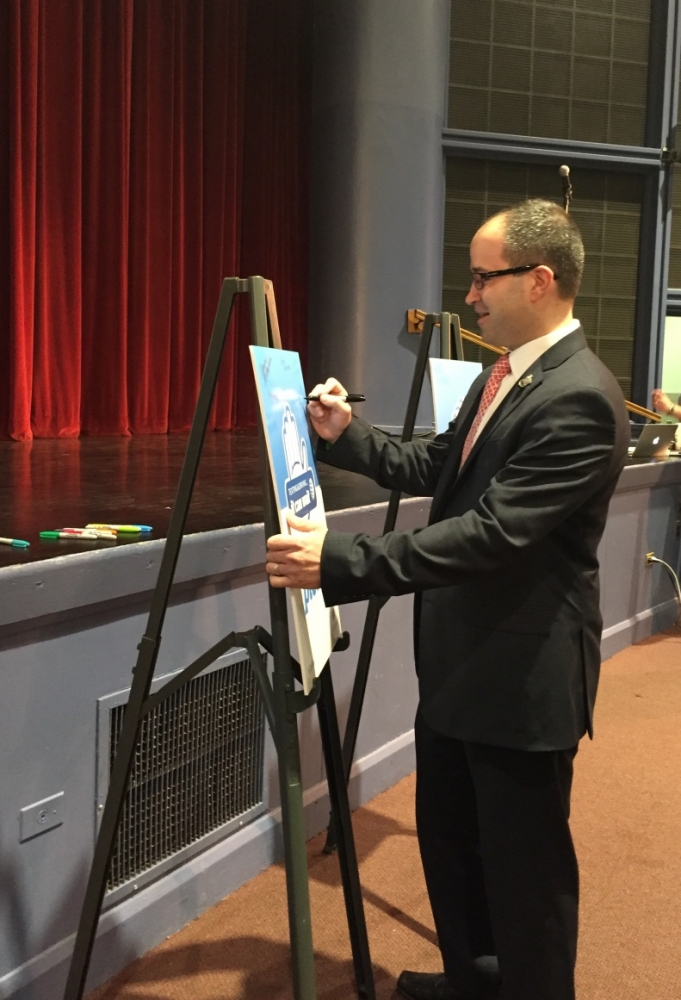 "Assemblyman Ed Ra (R-Franklin Square) signs AT&T's ""It Can Wait"" pledge to avoid distracted driving following his presentation at Garden City High School.<br />"