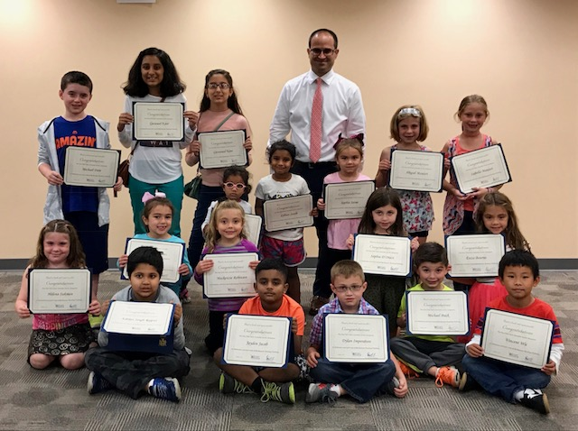 Assemblyman Ed Ra (R-Franklin Square) with local children who completed the Summer Reading Challenge on October 3 at the Hillside Public Library.<br />