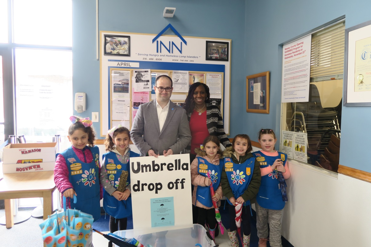 Assemblyman Ed Ra (R-Franklin Square) and Girl Scout Troop 1888 dropped off their donation of over 50 umbrellas to Cynthia Sucich, director of Corporate & Community Relations for the Mary Brennan