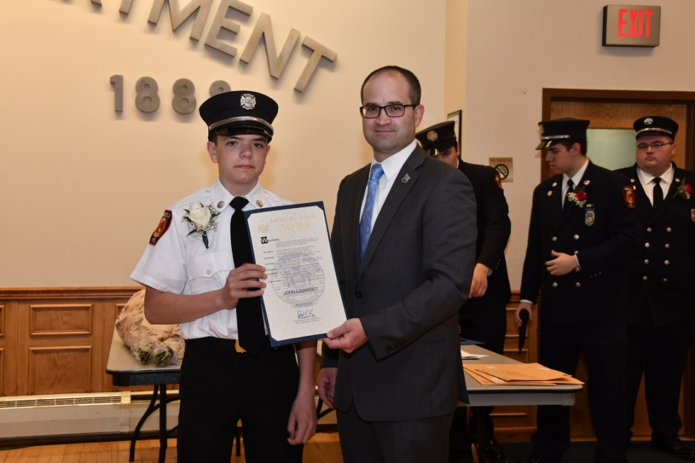 Assemblyman Ed Ra (R-Franklin Square) and John Lodigkeit, Junior Fire Fighter of the Year, at the Annual Installation Dinner for the Mineola Junior Fire Department on Saturday, April 28.