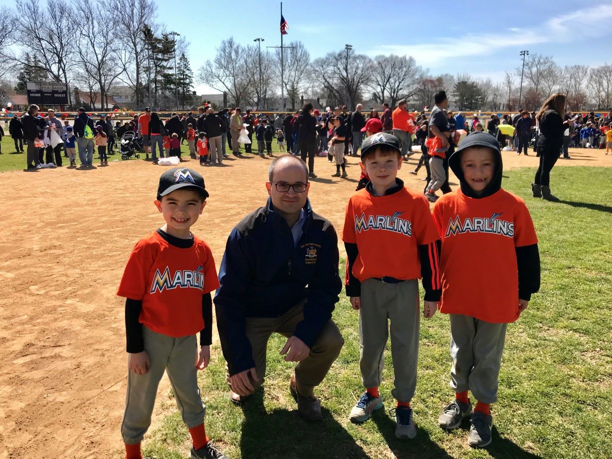 Assemblyman Ed Ra (R-Franklin Square) and members of the Franklin Square Little League 7-year-old Marlins team, Michael Buck, Chace Workman, and Kyle Farina.