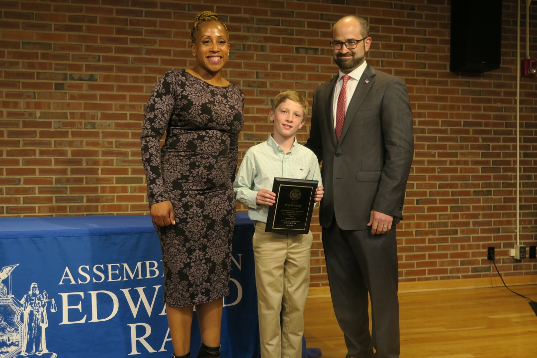 Assemblyman Ed Ra (R,C,I-Franklin Square) pictured with contest winner Will Brennan from Stratford Avenue School in Garden City. The second photo features Ra, Brennan and Karen Cummings from LiveOnNY.