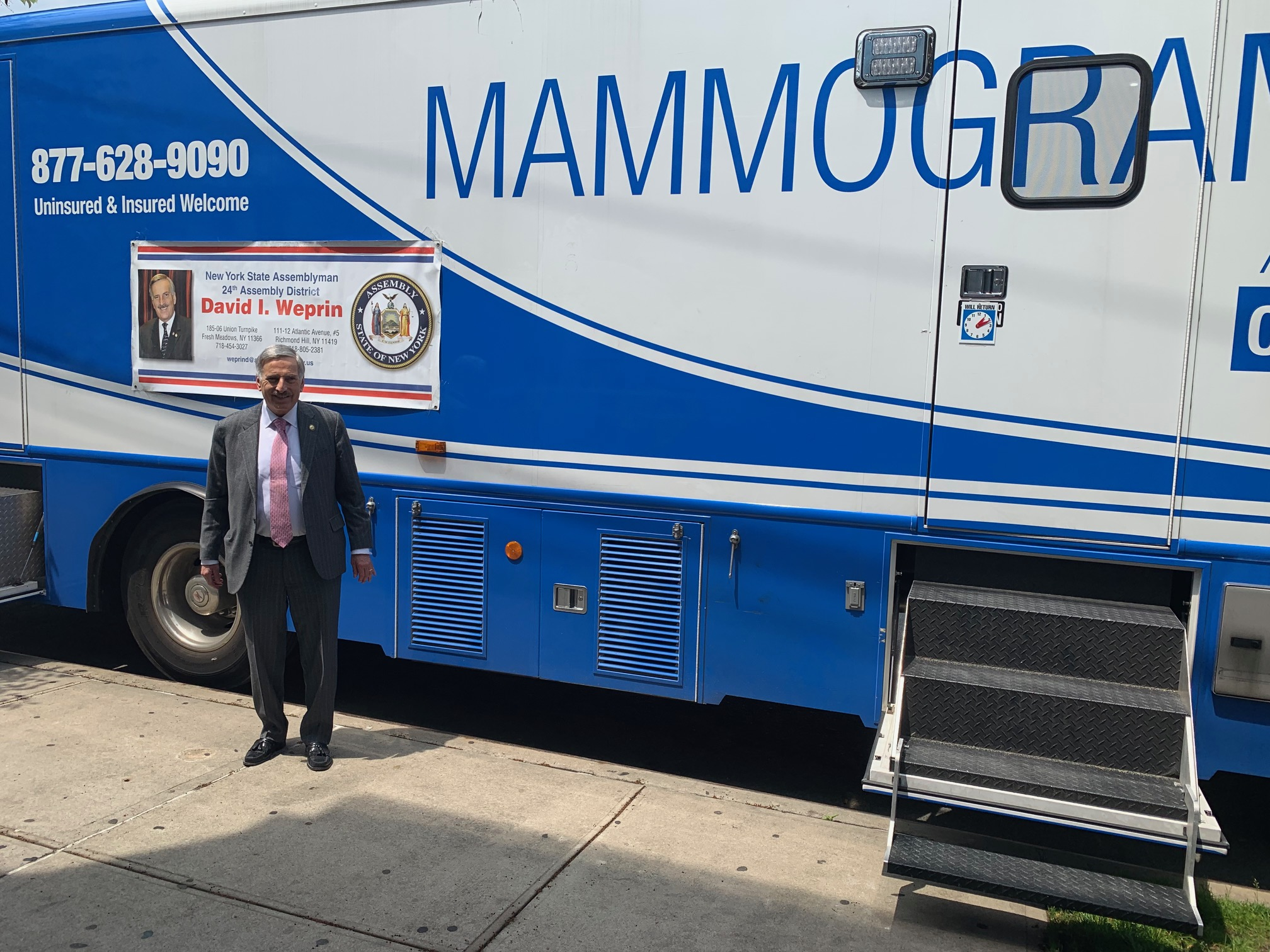 Assemblyman David Weprin stands with the Mammogram Van.