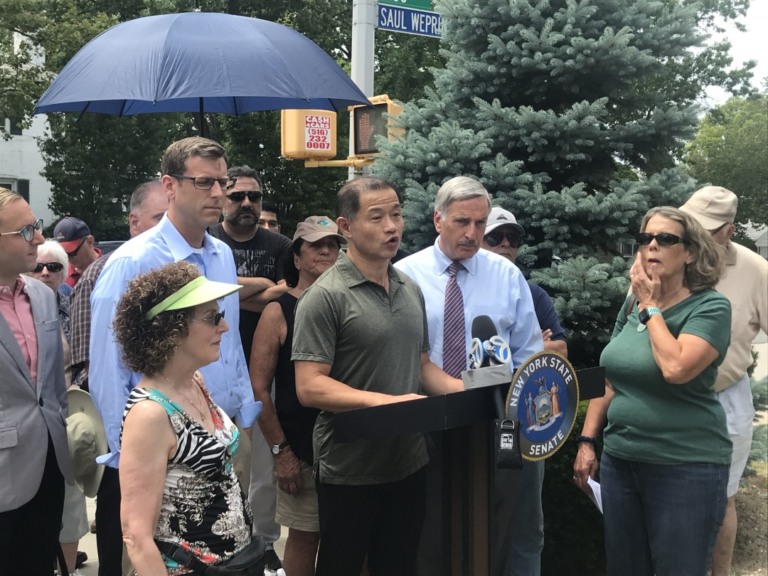 Assemblyman Weprin speaks alongside Senator John C. Liu, Assemblyman Ed Braunstein, civic leaders, and residents at 188th Street.
