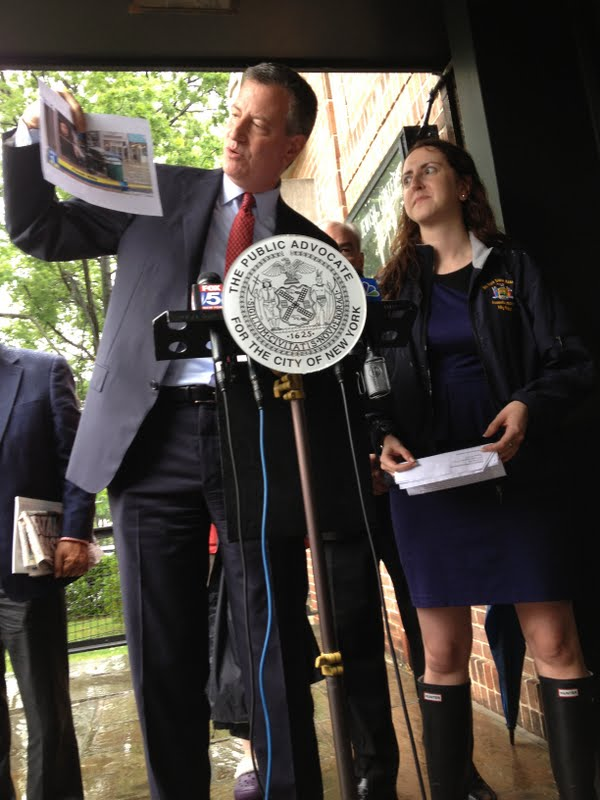 Assemblywoman Nily Rozic and Mayor Bill de Blasio held a joint press conference with homeowners in Fresh Meadows calling for sewer upgrades and more responsive policies to handle frequent flooding in Queens.