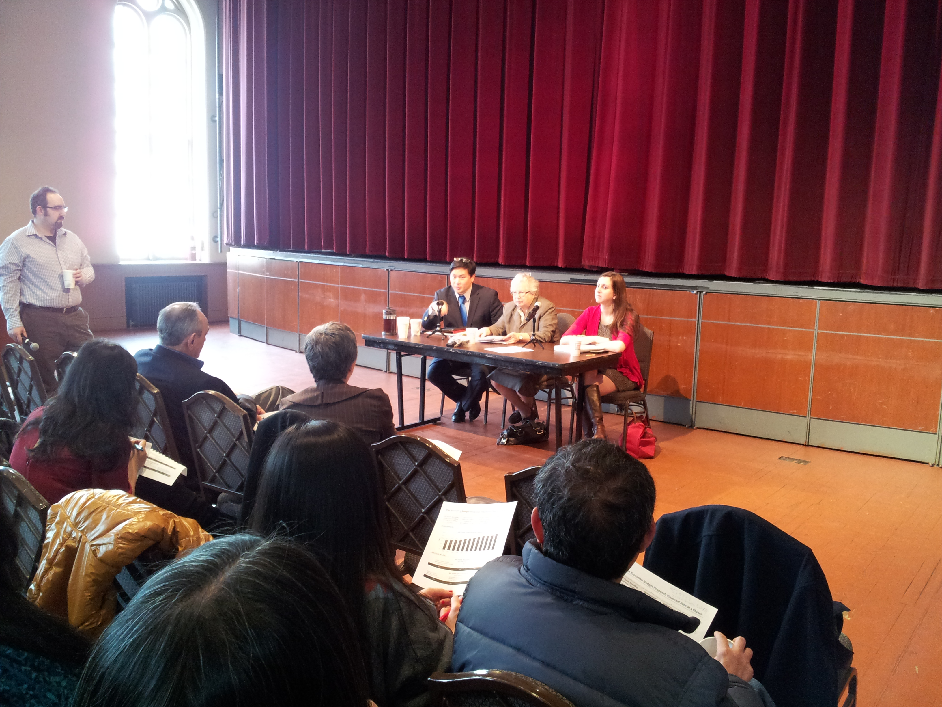 Assemblywoman Nily Rozic joins State Senator Toby Ann Stavisky and Assemblymember Ron Kim to discuss the state budget process at Flushing Town Hall.