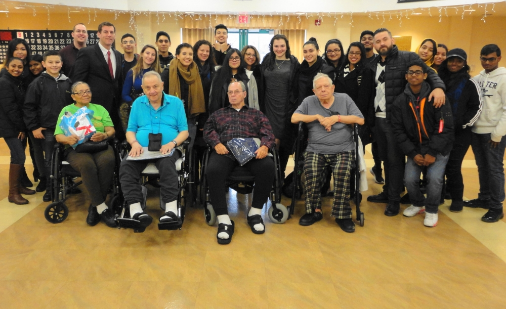 Assemblyman Braunstein, his staff, and students and staff from Benjamin N. Cardozo High School are pictured on December 21, 2016 with veterans at the NYS Veterans Home at St. Albans.