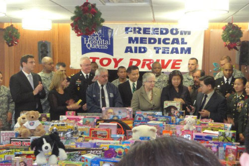 On Friday, December 9, 2011, Assemblyman Braunstein delivered toys donated by constituents of the 26th Assembly District to New York Hospital's Freedom Medical Assistance Team's toy drive, pictured here with members of FreeMAT, Senator Toby Ann Stavisky, Assemblywoman Grace Meng, New York City Comptroller John Liu, and New York City Councilman Peter Koo.
