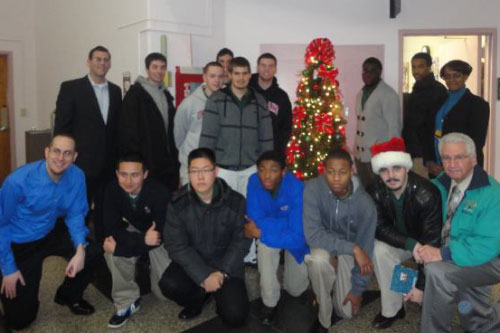 On Tuesday, December 20, 2011, Assemblyman Braunstein and his staff delivered gifts for veterans at the St. Albans Community Living Center of the VA New York Harbor Healthcare System and the New York State Veterans� Home at St. Albans with students from Holy Cross High School, and Michael Genovese, Director of Service Learning.