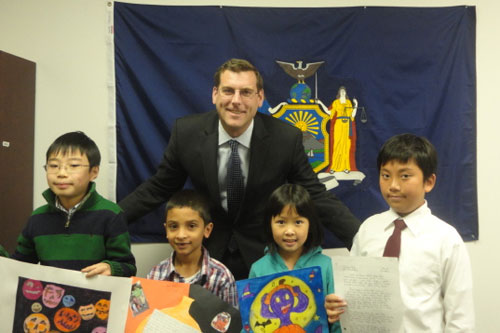 On November 28, 2012, Assemblyman Braunstein congratulated the winners of his Halloween Essay and Drawing Contest 2012. Pictured from left to right: 4th Grade Grand Prize Winner, Christopher Du; 2nd Grade Grand Prize Winner, Aaron Omar, Assemblyman Edward Braunstein; 3rd Grade Grand Prize Winner, Wen Fei Lin and 5th Grade Grand Prize Winner, Vincent Fong.