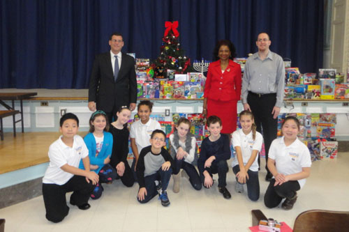 On December 18, 2012, Assemblyman Braunstein received donations for his Holiday Toy Drive from PS 98, pictured here with PS 98�s Principal Sheila Huggins, Chief of Staff David Fischer and PS 98's Student Council.