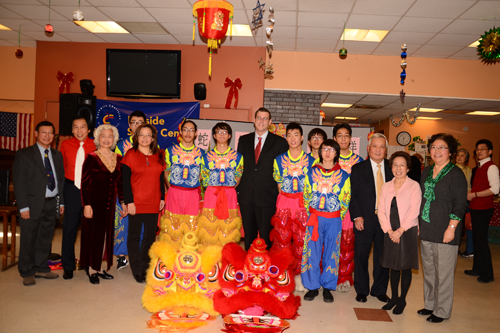 On February 2, 2013, Assemblyman Braunstein visited the Key Luck Club at Bayside Senior Center to watch their Lunar New Year performances, pictured here with President Irene Cheung and the performers.