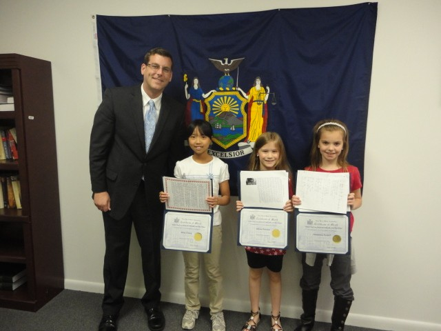 On Friday, June 14, 2013, Assemblyman Braunstein congratulated the winners of his Mother's Day Essay and Poetry Contest 2013. Pictured from left to right: Assemblyman Edward Braunstein; 4th Grade Grand Prize Winner, Rena Chang; 2nd Grade Grand Prize Winner, Allison Petrenas and 3rd Grade Grand Prize Winner, Samantha Fordell.
