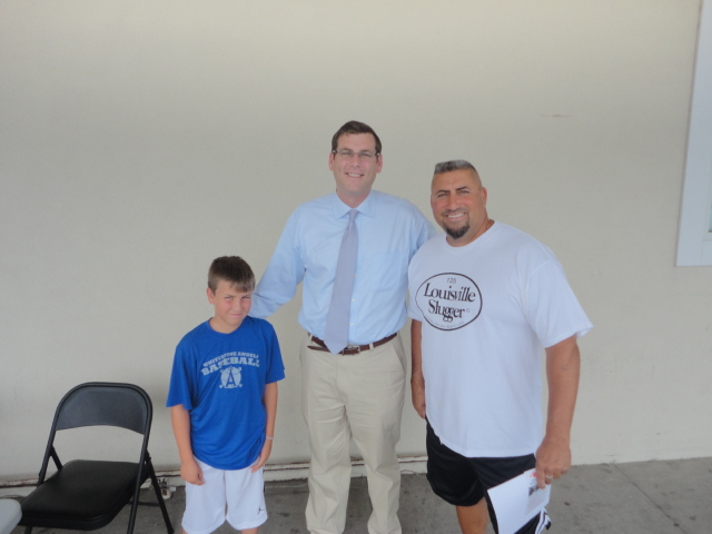 On Saturday, August 10, 2013, Assemblyman Braunstein hosted a Mobile District Office near the Key Food in the Whitestone Shopping Center. Assemblyman Braunstein is pictured here with constituents, Eddy Lopez of the Whitestone Angels and his son, Matthew.