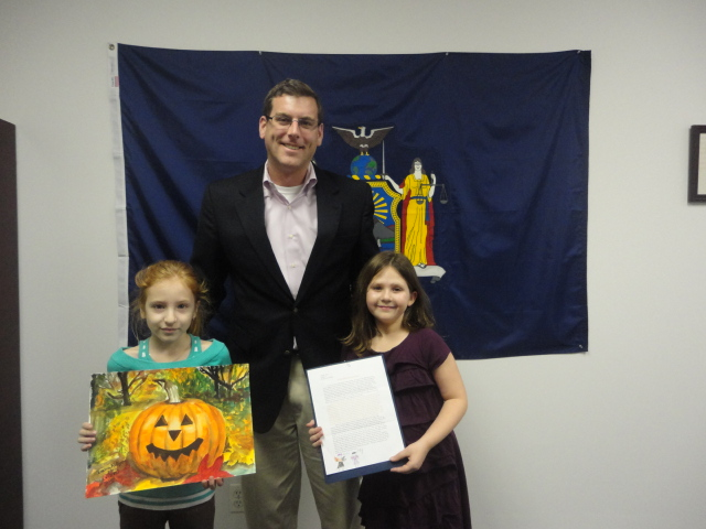 On November 22, 2013, Assemblyman Braunstein congratulated the winners of his Halloween Essay and Drawing Contest 2013. Assemblyman Braunstein is pictured here with 4th Grade Grand Prize Winner Ilana Kuliyev, and 3rd Grade Grand Prize Winner Abigail Stein. (2nd Grade Grand Prize Winner Kevin Lin not pictured).