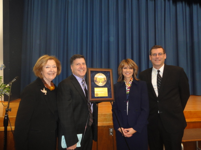 On Monday, December 2, 2013, Assemblyman Braunstein attended PS 221's celebration in recognition of its 2013 National Blue Ribbon award. Assemblyman Braunstein is pictured with Councilman Mark Weprin, School District 26 Superintendent Anita Saunders, and Principal Patricia Bullard.