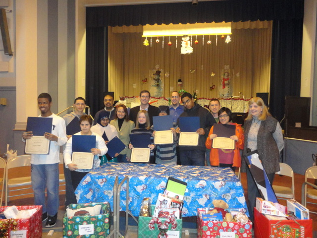 On December 17, 2013, Assemblyman Braunstein received donations for his Holiday Toy Drive from PS 811Q, pictured here with PS 811 staff and Student Council.