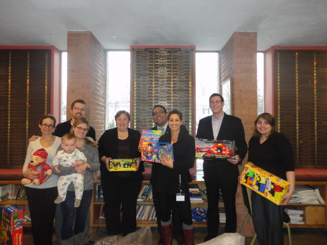 On December 17, 2013, Assemblyman Braunstein delivered toys donated to his annual Holiday Toy Drive to QSAC Preschool & Early Childhood Center of Douglaston, pictured here with staff and parents of students attending the school.