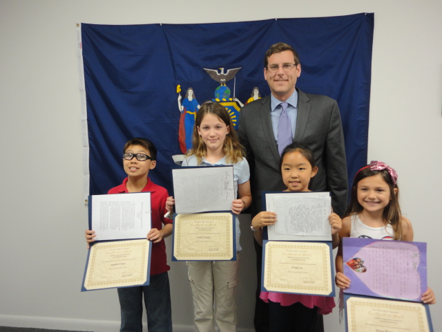 On May 30, 2014, Assemblyman Braunstein congratulated the winners of his Mother's Day Essay and Poetry Contest 2014. Pictured from left to right: 4th Grade Grand Prize Winner Jayden Chen of PS 94, 5th Grade Grand Prize Winner Faith Lutzky of Sacred Heart School, Assemblyman Edward C.  Braunstein, 3rd Grade Grand Prize Winner Fiona Lu of PS 209, and 2nd Grade Grand Prize Winner Alexa Piotrowski of St. Andrew Avellino School.