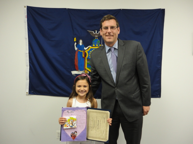 On May 30, 2014, Assemblyman Braunstein congratulated the 2nd Grade Grand Prize Winner of his Mother's Day Essay and Poetry Contest 2014, Alexa Piotrowski of St. Andrew Avellino in Flushing.