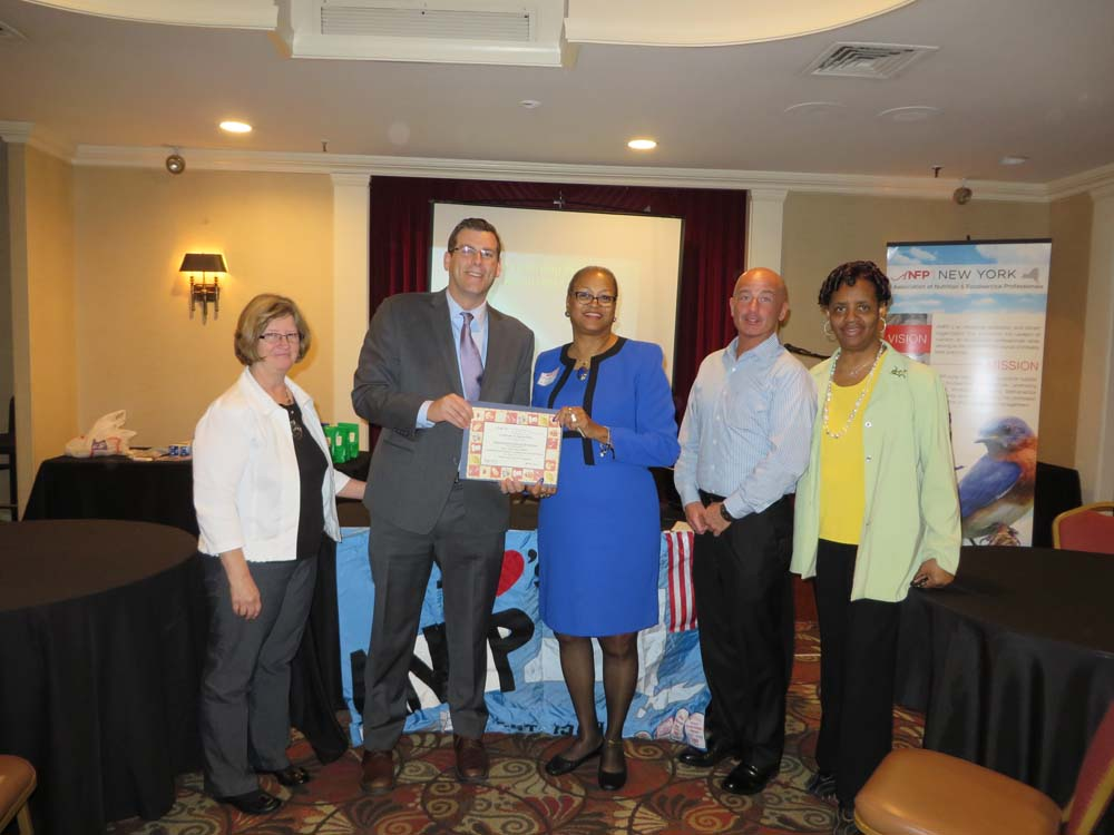 On April 25, 2014, Assemblyman Braunstein attended the state meeting of the New York Association of Nutrition & Foodservice Professionals (ANFP). Assemblyman Braunstein is pictured with ANFP National President Paula Bradley, New York State ANFP President Evelyn Conner, ANFP Culinary Chair Michael Roddey, and New York State ANFP President-Elect Francine Freeman.