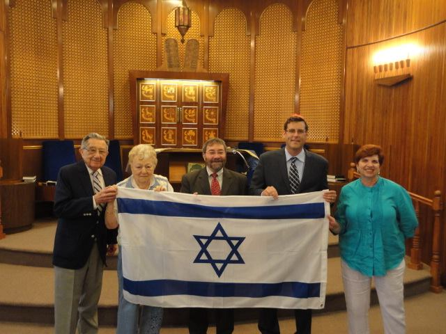 On July 24, 2014, Assemblyman Braunstein presented a new Israeli flag to the members of the Clearview Jewish Center. Assemblyman Braunstein is pictured with Rabbi David Taub, Clearview Jewish Center President Sam Weiss, Clearview Jewish Center Sisterhood President Regina Elias, and Secretary of the Sisterhood Ruby Cohen.