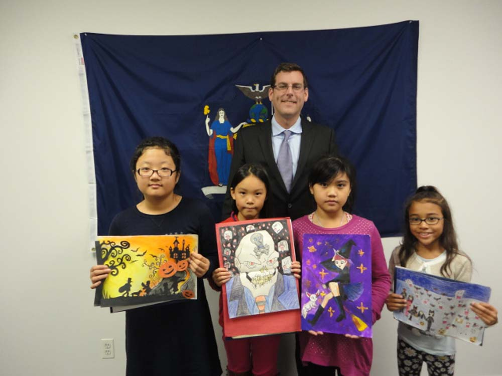 On November 24, 2014, Assemblyman Braunstein congratulated the winners of his Halloween Essay and Drawing Contest 2014. Assemblyman Braunstein is pictured with 3rd Grade Grand Prize Winner Ashley Cho, 5th Grade Grand Prize Winner Angela Chen, 4th Grade Grand Prize Winner Elicia Chau, and 2nd Grade Grand Prize Winner Adriana St. Clair.