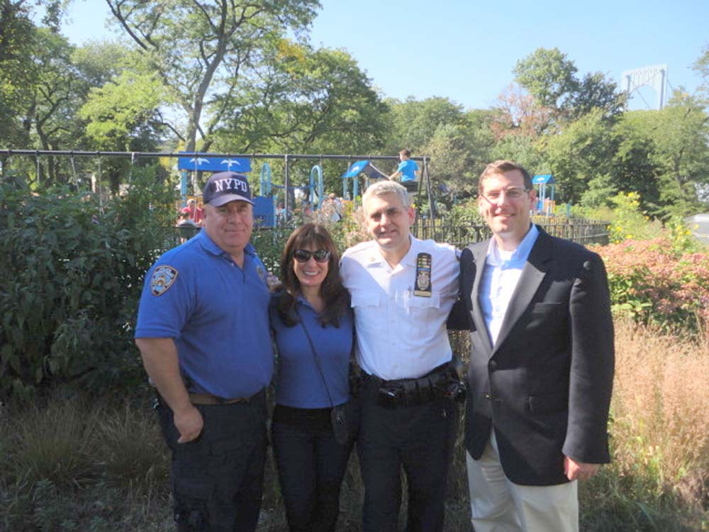 Assemblyman Braunstein attended the 109th Precinct's First Annual Family Fun Day. Assemblyman Braunstein is pictured with Detective Kevin O'Donnell of the 109th Precinct's Community Affairs Unit, 109th Precinct Community Council President Chrissy Voskerichian, and Commanding Officer Captain Thomas Conforti.
