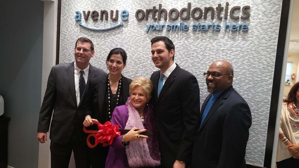 On November 14, 2014, Assemblyman Braunstein attended the ribbon cutting ceremony for Avenue Orthodontics in Whitestone. Assemblyman Braunstein is pictured with Dr. Abraham Chahine; Dr. Eleni Michailidis; Victoria Schneps, Publisher and CEO of Schneps Communications; and Dr. Johnson Rethinasamy, Pastor of the Immanuel Lutheran Church in Whitestone.