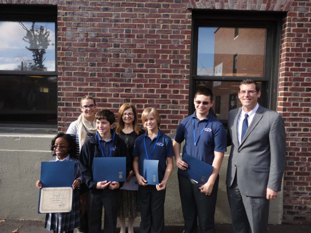 On November 12, 2014, Assemblyman Braunstein inducted the newly elected Divine Wisdom Catholic Academy of Douglaston Student Council Officers and Representatives for the 2014-2015 school year. Assemblyman Braunstein is pictured with Principal Michael LaForgia, Student Council Moderators Ms. Michelle Furlong and Ms. Marianne Pagano, and the Divine Wisdom Catholic Academy of Douglaston Student Council Officers.
