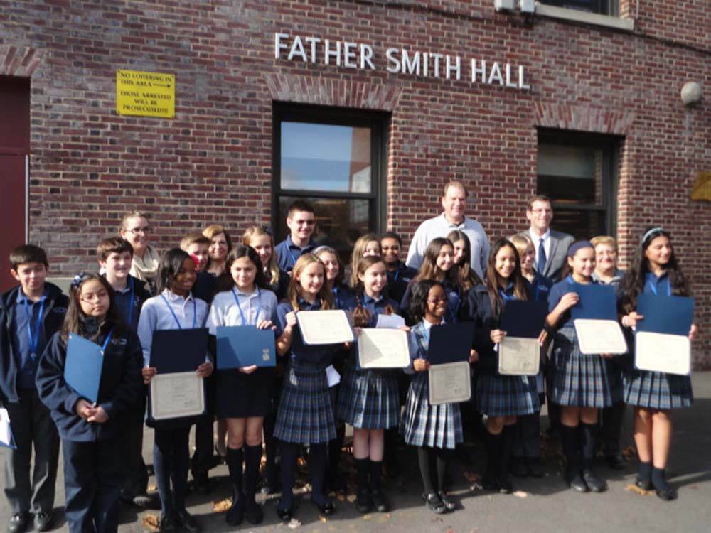 On November 12, 2014, Assemblyman Braunstein inducted the newly elected Divine Wisdom Catholic Academy of Douglaston Student Council Officers and Representatives for the 2014-2015 school year. Assemblyman Braunstein is pictured with Principal Michael LaForgia, Student Council Moderators Ms. Michelle Furlong and Ms. Marianne Pagano, and the Divine Wisdom Catholic Academy of Douglaston Student Council Officers and Representatives.