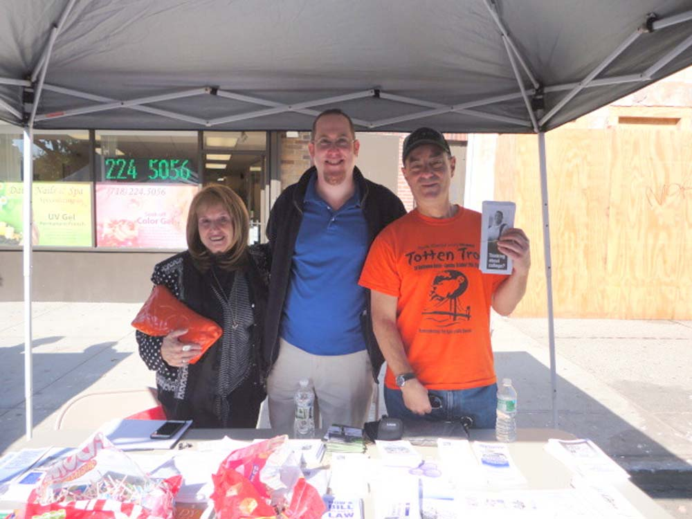 Assemblyman Braunstein's staff hosted a Mobile District Office at the Bayside Village BID's Annual Halloween Festival. Assemblyman Braunstein's Chief of Staff David Fischer is pictured with Bayside Hills Civic Association President Michael Feiner, and his wife Eileen Feiner.