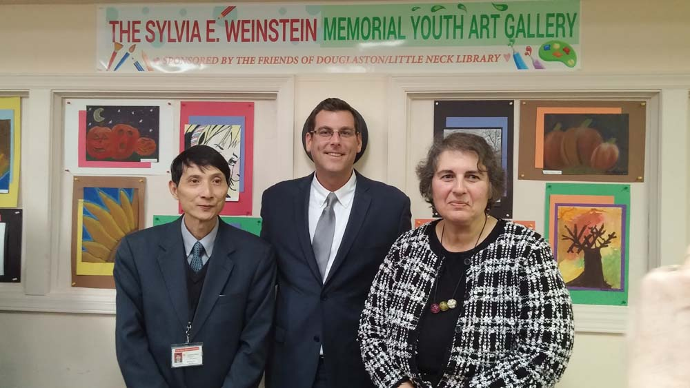 Assemblyman Braunstein attended the Second Unveiling of the Sylvia E. Weinstein Youth Art Gallery. Assemblyman Braunstein is pictured with Branch Manager Ron Wan and Arline Abdalian, President of the Friends of Douglaston/Little Neck Library.