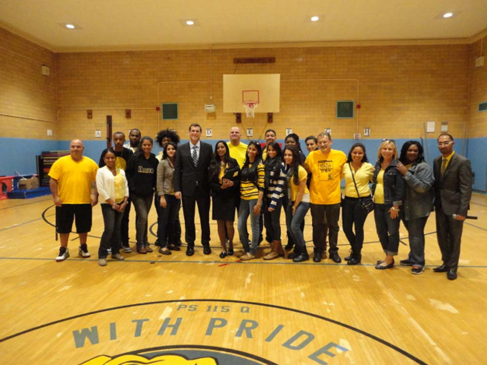 Assemblyman Braunstein visited the Samuel Field Y's COMPASS NYC Program at PS 115 for their Annual Lights on Afterschool event. Assemblyman Braunstein is pictured with Site Director Michelle Ragoo and the staff of the PS 115 COMPASS NYC Program.