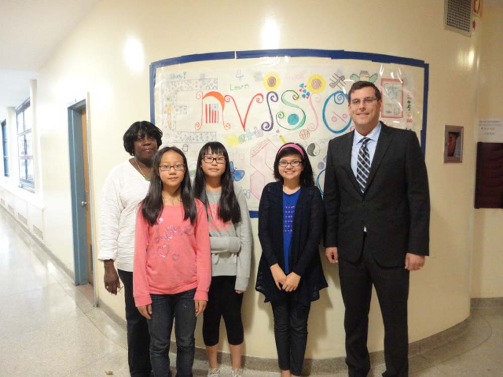 Assemblyman Braunstein visited the Samuel Field Y's Beacon Program at MS 158 for its Annual Lights on Afterschool event. Assemblyman Braunstein is pictured with Site Director Martenia Miller and students attending the MS 158 Beacon Program.