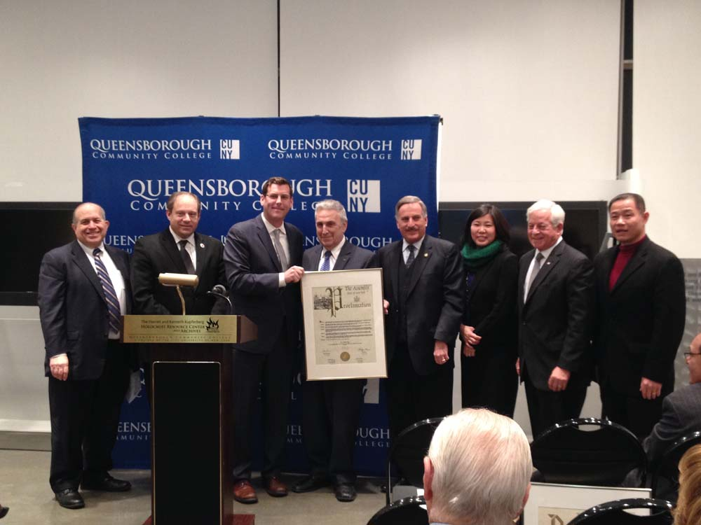 On December 8, 2014, Assemblyman Braunstein presented a New York State Assembly Proclamation to Dr. Arthur Flug, retiring Executive Director of the Kupferberg Holocaust Resource Center & Archives. Assemblyman Braunstein is pictured with Congresswoman Grace Meng, Assemblymen David Weprin and Charles Lavine, Council Member Rory Lancman, former Comptroller John Liu, and Mark Kupferberg, son of KHRCA donors Harriet and Kenneth Kupferberg.