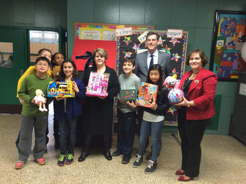 On December 10, 2014 Assemblyman Braunstein attended PS 209's Holiday Celebration, where he received donations to his Annual Toy Drive from PS 209 students. Assemblyman Braunstein is pictured with Principal Mary McDonnell, Assistant Principal Jacqueline Diaz Fernandez, and students of PS 209.