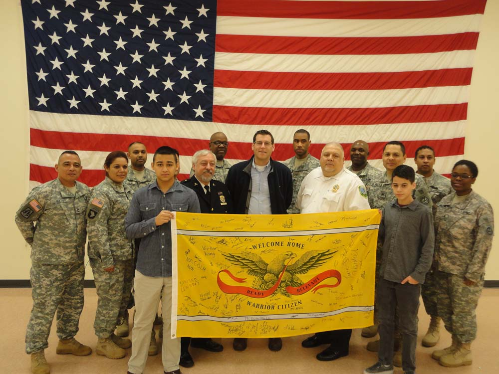 On December 14, 2014, Assemblyman Braunstein received the Warrior Citizen flag from the United States Army at Fort Totten, in recognition of donations from his office to Operation FreeMAT, one of the recipients of gifts from his office's Annual Holiday Toy Drive.