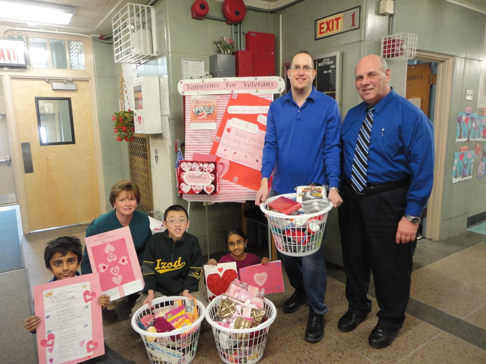 Assemblyman Braunstein's Chief of Staff David Fischer is pictured with Student Council Moderator Mary O'Donoghue, Parent Coordinator Kevin Burke, and members of the Student Council of PS 115, one of the 28 schools that participated in the 19th annual Valentines for Vets gift drive.