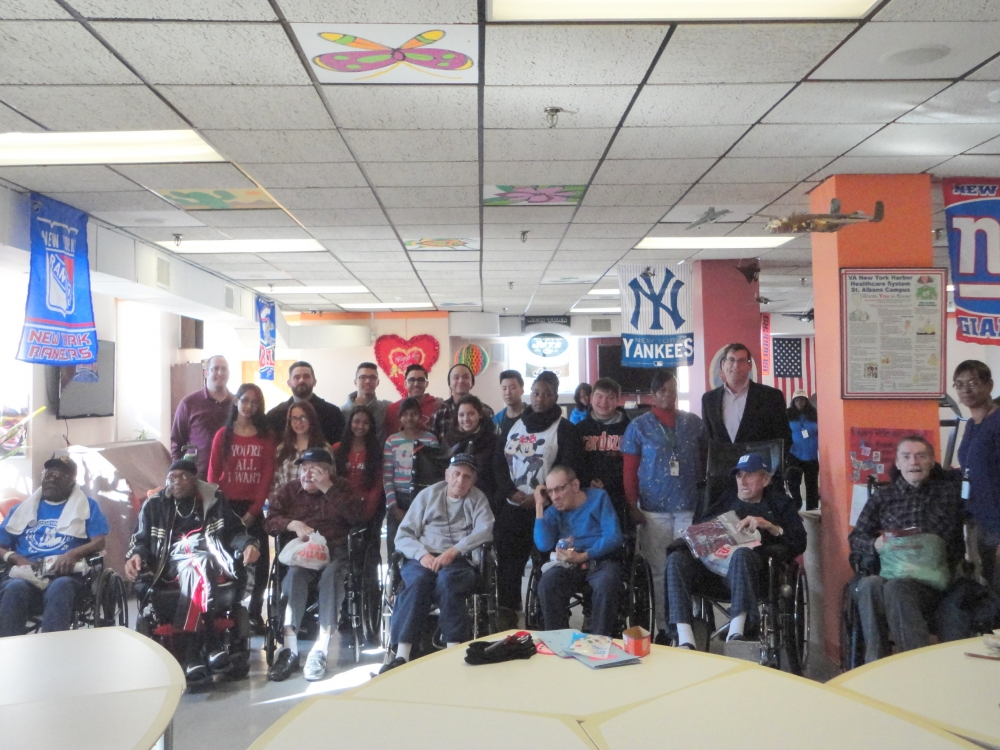 On February 13, 2015, Assemblyman Braunstein delivered donations from the 19th annual Valentines for Vets gift drive to the St. Albans VA Community Living Center. Assemblyman Braunstein is pictured with hospitalized veterans, as well as his staff, St. Albans VA Assistant Chief of Voluntary Service Lisa Cummings, Benjamin N. Cardozo High School students, and Cardozo High School Assistant Principal Peter Georgatos.