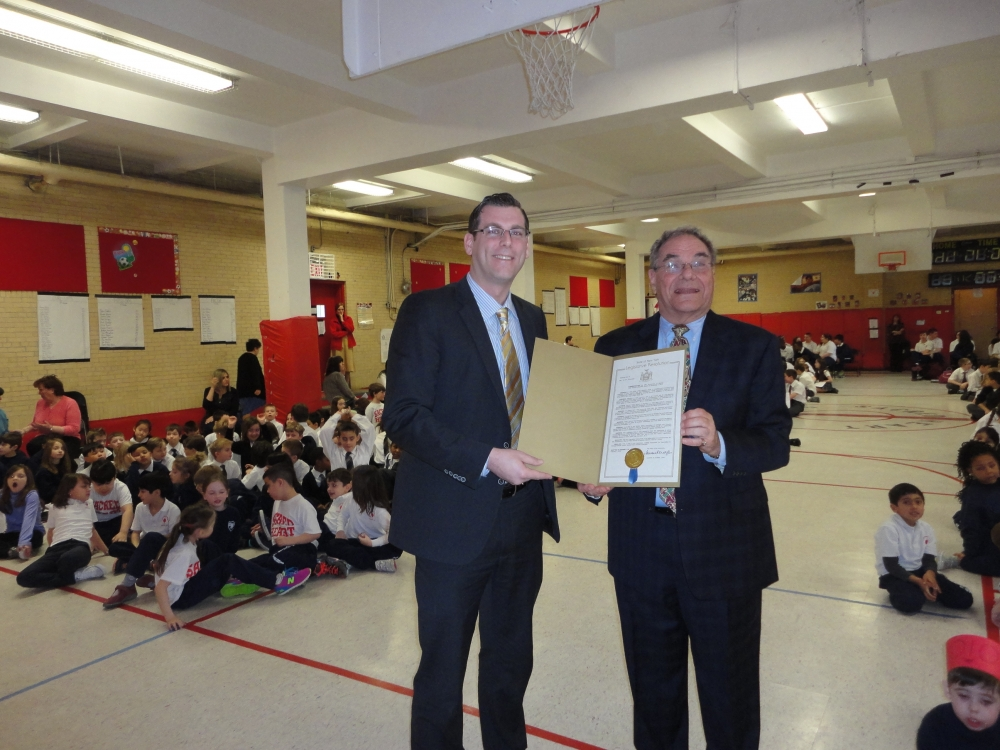 On March 13, 2015, Assemblyman Braunstein presented a New York State Legislative Resolution in honor of Sacred Heart School's 90th Anniversary to Principal Dennis Farrell.