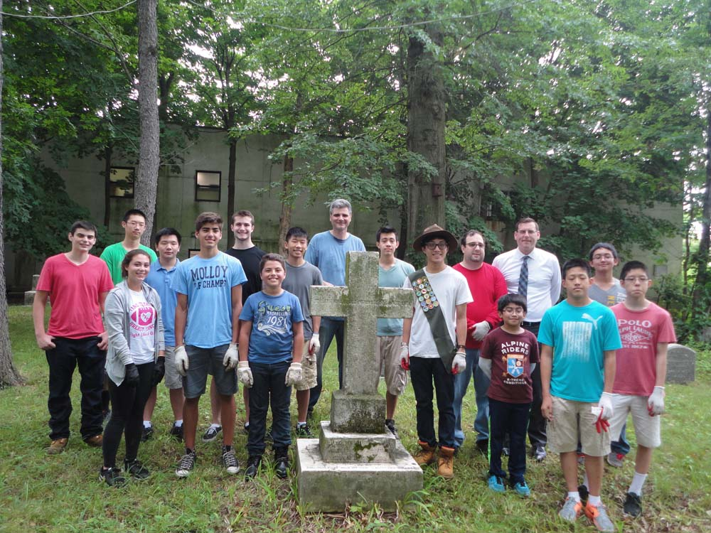 On July 15, 2015, Assemblyman Braunstein attended a cleanup of Lawrence Cemetery coordinated by his office and organized by Eagle Scout Andrew Bow and Bayside Historical Society member Peter Sutich. Mr. T's Carting assisted with the removal of debris.