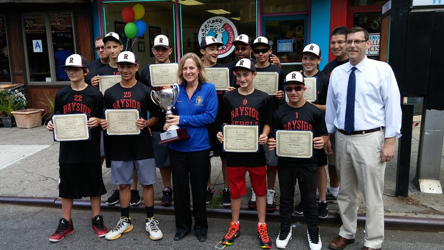On September 27, 2015, Assemblyman Braunstein co-sponsored this year's Bayside Village BID Sunday Stroll, where he presented a New York State Assembly Citation of Merit to the Bayside Little League 13U Rebels in recognition of winning the Borough Cup Championship. Assemblyman Braunstein is pictured with the Queens Borough President Melinda Katz and the Rebels.