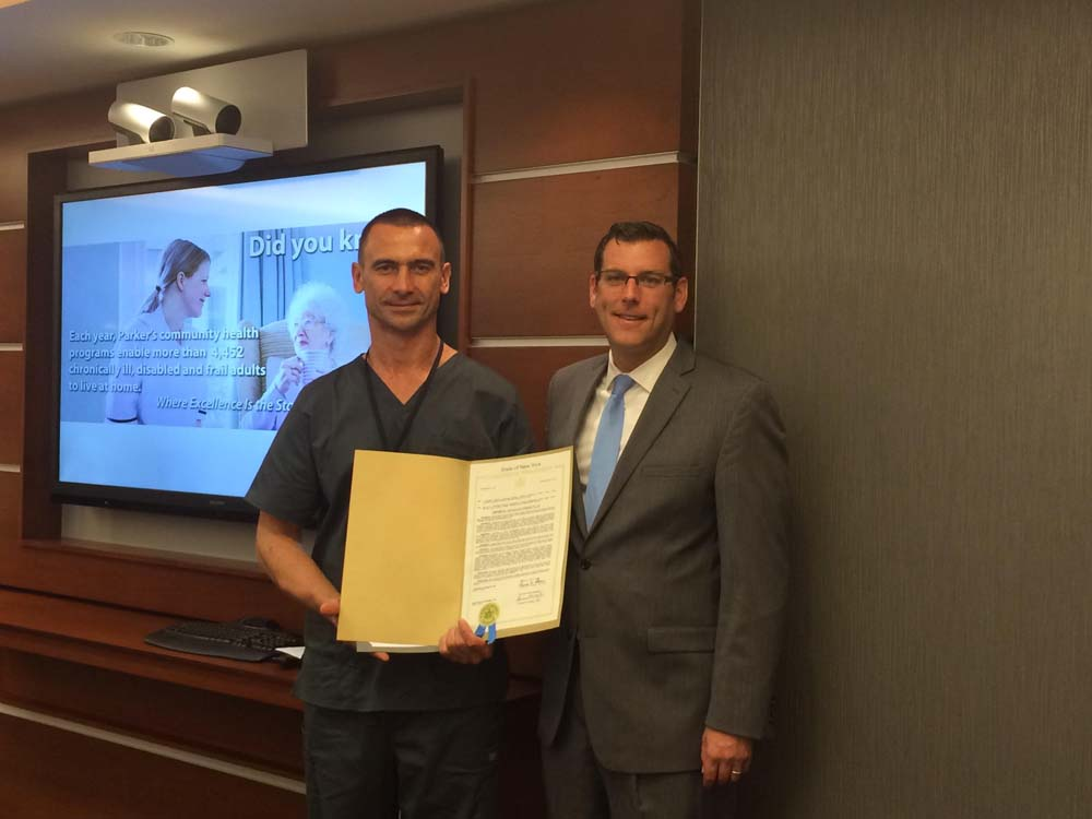 On October 13, 2015, Assemblyman Braunstein presented a NYS Legislative Resolution to Pawel Jakubiec, recipient of the LeadingAge New York Employee of Distinction Award. Assemblyman Braunstein is pictured with Pawel Jakubiec.