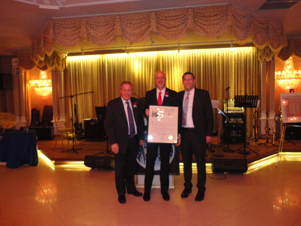 On October 15, 2015, Assemblyman Braunstein presented a NYS Assembly Proclamation to Transitional Services for New York, Inc. and its CEO Dr. Larry Grubler in recognition of its 40th Anniversary, with the evening's Master of Ceremonies Council Member Daniel Dromm.