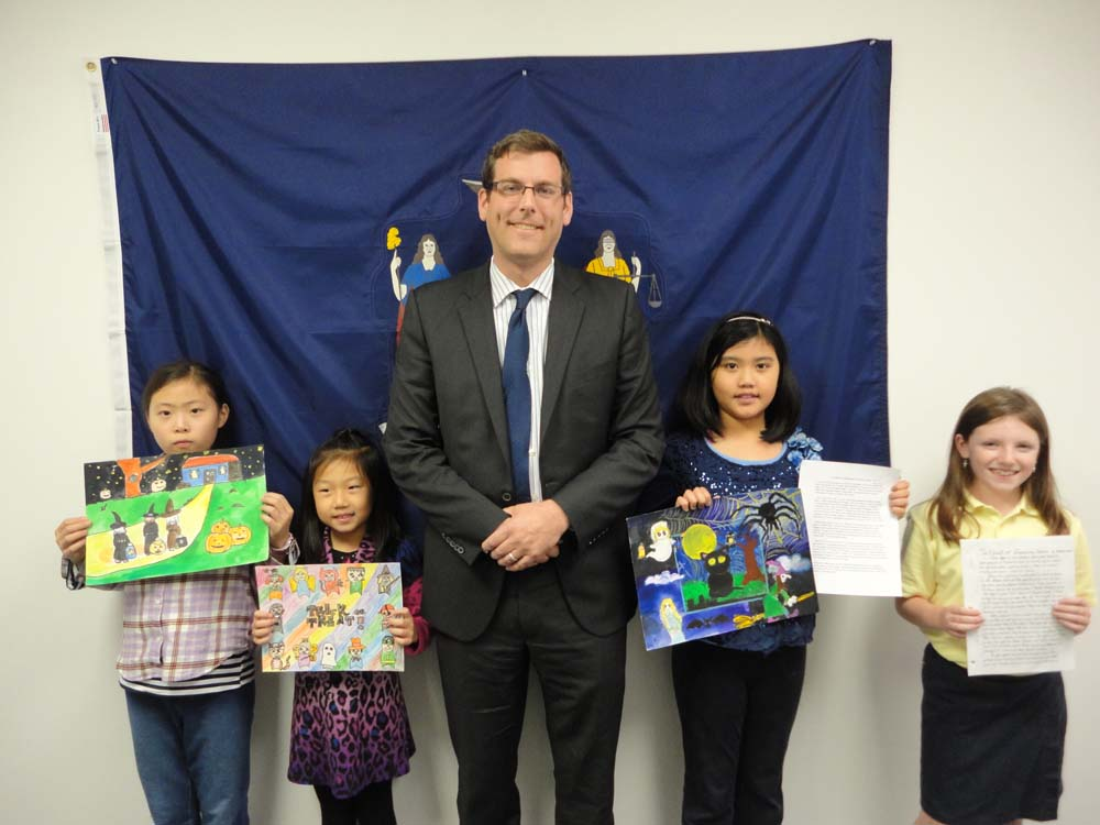 On November 19, 2015, Assemblyman Braunstein congratulated the winners of his Halloween Essay and Drawing Contest 2015. Assemblyman Braunstein is pictured with 3rd Grade Grand Prize Winner Sabrina Xu, 2nd Grade Grand Prize Winner Jessica Zhang, 5th Grade Grand Prize Winner Elicia Chau, and 4th Grade Grand Prize Winner Madelyn Brosi.